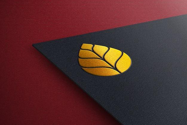Elegant gouden logo mockup met zwart papier
