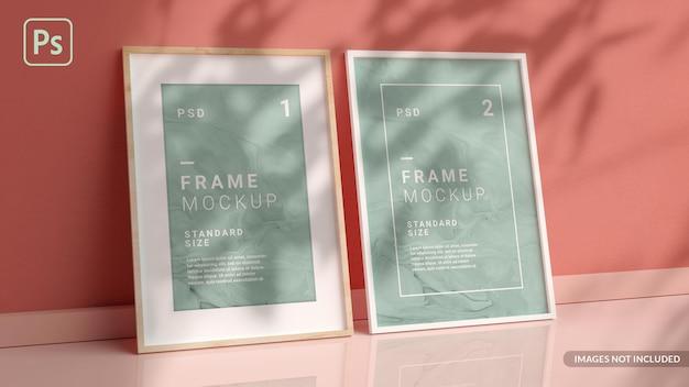 Elegante fotolijsten mockup op de vloer leunend tegen de muur in 3d-weergave