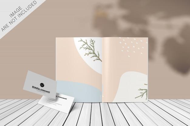 Elegante libro y tarjeta de visita con superposición de sombras