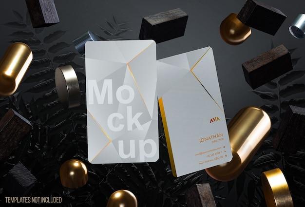 Elegante tarjeta de visita con objetos levitando.