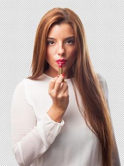 Elegante vrouw die een lippenstift gebruikt