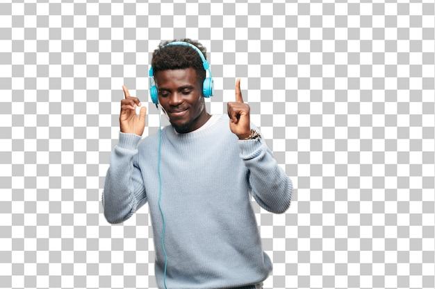 Escuchar música joven negro con sus auriculares