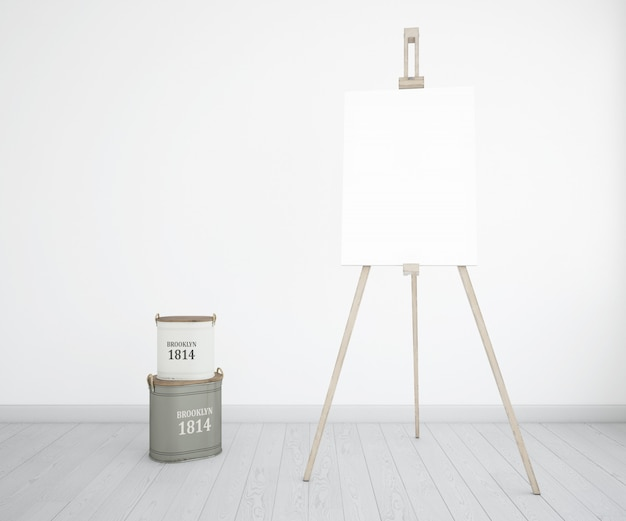 Estudio de arte con lienzo y botellas de pintura.