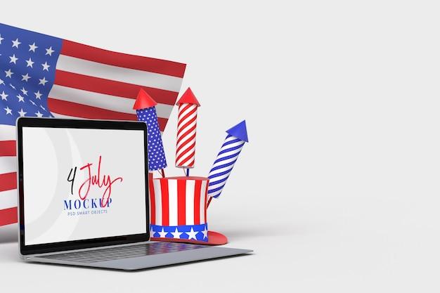 Feliz 4 de julio, día de la independencia de ee. uu. y maqueta de computadora portátil con decoración y bandera estadounidense