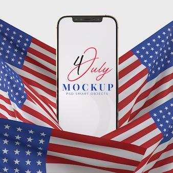 Feliz 4 de julio, día de la independencia de ee. uu. y maqueta de teléfono inteligente con decoración y bandera estadounidense