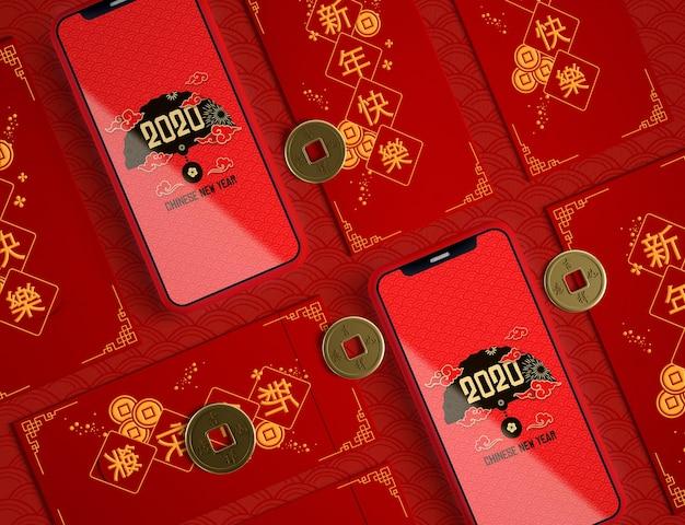 Feliz año nuevo ilustración con maqueta de teléfonos
