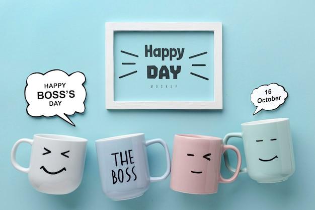 Feliz día del jefe con marco y tazas