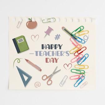 Feliz día del maestro con vista superior de útiles escolares