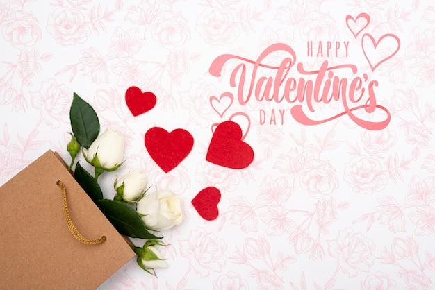 Feliz día de san valentín letras con ramo de rosas