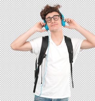 Feliz joven estudiante escuchando música