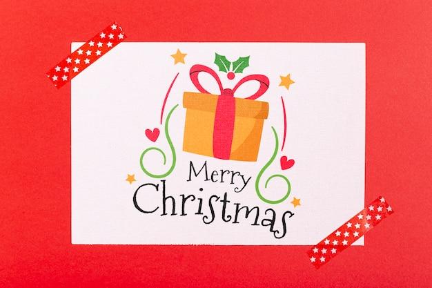 Feliz navidad con caja de regalo y cintas