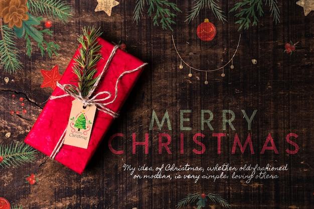 Feliz navidad deseo con regalo al lado