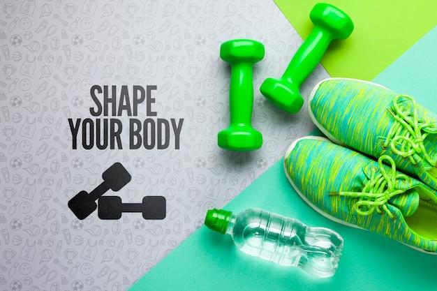 Fitnessapparatuur en waterfles