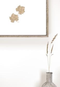 Florero con flores y marco de pared con hojas