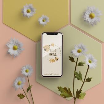 Flores 3d con móvil en mesa