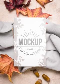 Foglie secche su carta da cucina autunno mock-up verticale