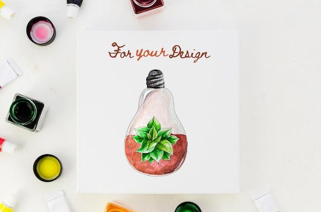 Foglio di carta con disegno realistico e pallette colorate