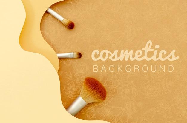 Fondo de cosméticos con set de pinceles