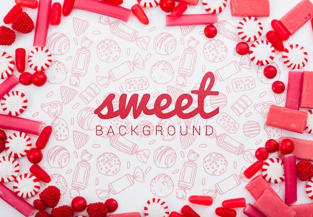 Fondo dulce rodeado de deliciosos dulces de azúcar
