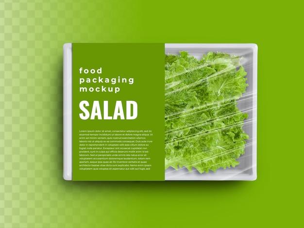 Food box tray container mockup met biologische groene salade in plastic verpakking papieren etiket