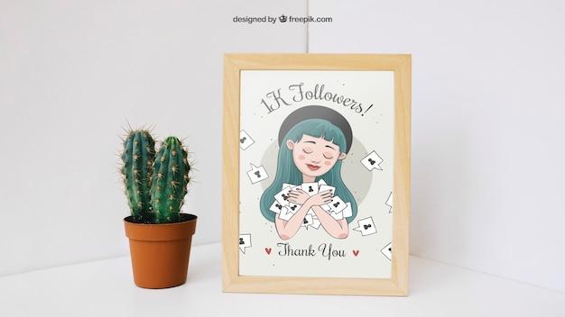 Foto frame mockup met cactus in de hoek