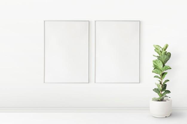 Fotolijst mockup psd hangend in een minimale woonkamer