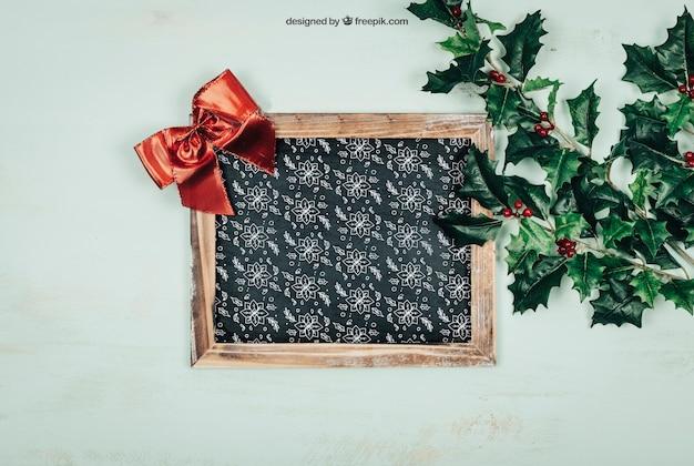 Frame en bladeren mockup met christmtas-ontwerp