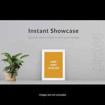 Frame op grijze muur met plant bespot je