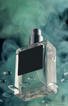 Frasco de perfume y humo verde.