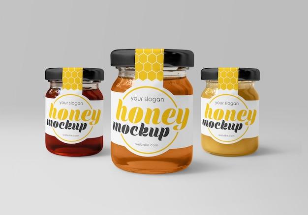 Frascos de vidrio con diferentes maquetas de miel.
