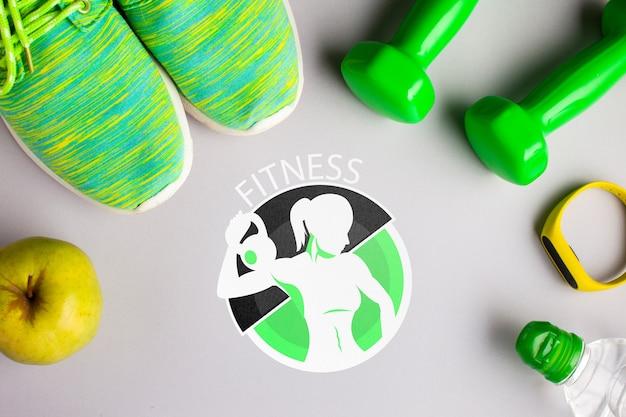 Frutas frescas y aparatos de ejercicios