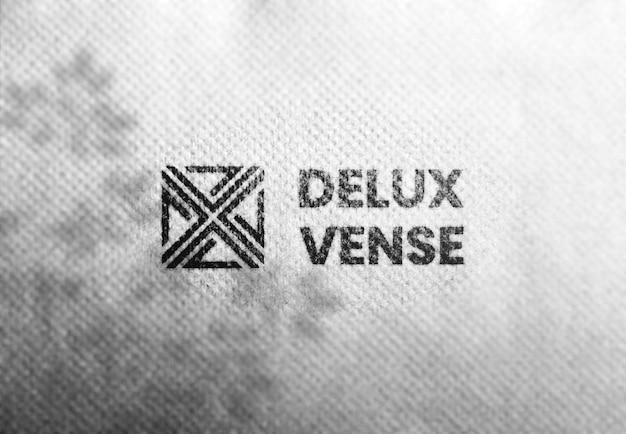 Gebrande logo mockup op witte textuur achtergrond