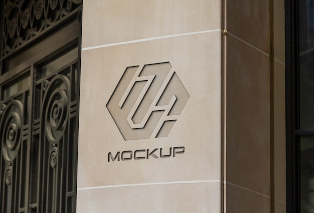 Gegraveerd logo op stenen bedrijfsmuur mockup