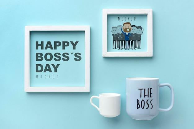 Gelukkige baas dag met frames en mokken