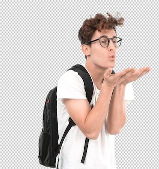 Gelukkige jonge student met een gebaar van het verzenden van een kus