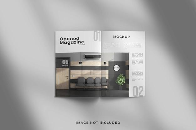 Geopend tijdschrift of brochure bovenaanzicht mockup