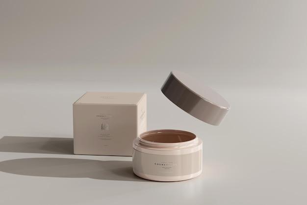Geopende cosmetische pot met doosmodel