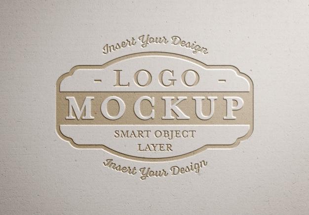 Geperst logo op wit papier textuur