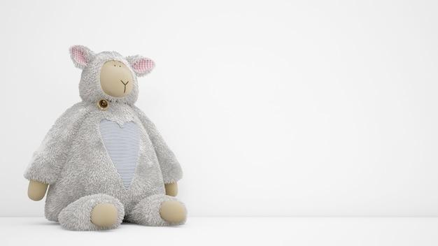 Gevuld dierlijk stuk speelgoed over witte muur met copyspace