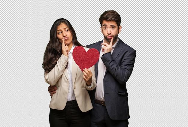 Giovane coppia a san valentino dubitando e confuso