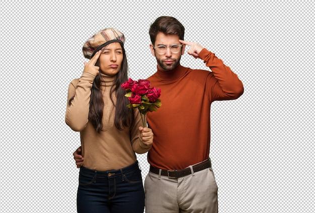 Giovane coppia in giorno di san valentino facendo un gesto di concentrazione