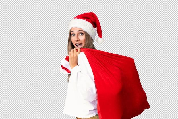 Giovane donna bionda, raccogliendo una borsa piena di regali