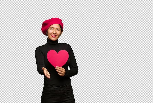 Giovane donna in giorno di san valentino raggiungendo per salutare qualcuno