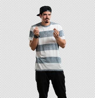 Giovane rapper uomo triste e depresso, facendo un gesto di necessità, ripristinando in beneficenza