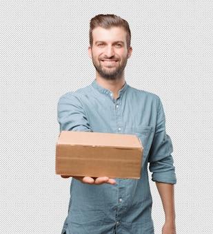 Giovane scatola di tenuta uomo bello