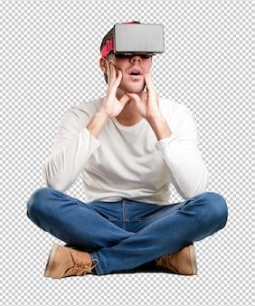 Giovane seduto con gli occhiali di realtà virtuale