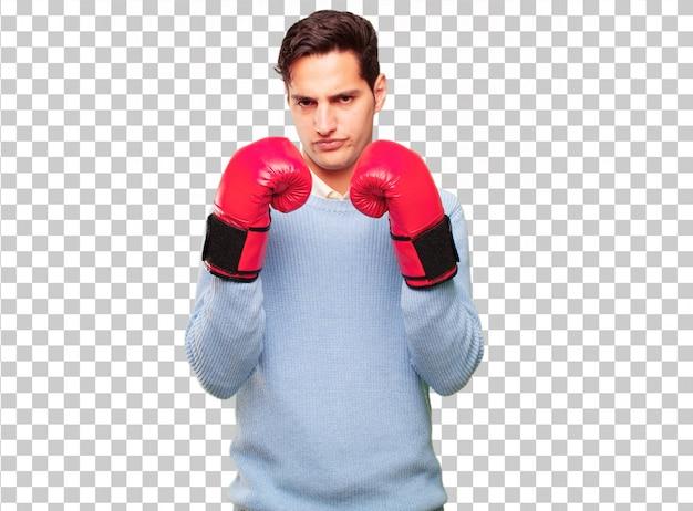 Giovane uomo abbronzato bello che indossa i guantoni da pugile