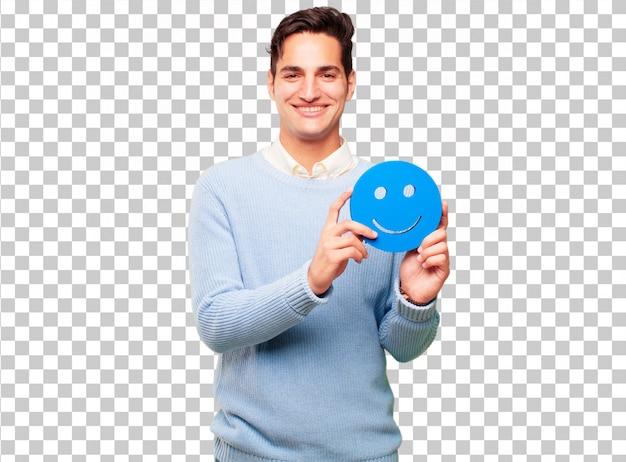 Giovane uomo abbronzato bello con un'emoticon sorridente