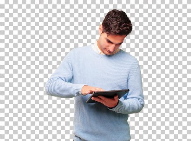 Giovane uomo abbronzato bello con un tablet touch screen