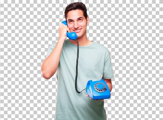 Giovane uomo abbronzato bello con un telefono vintage
